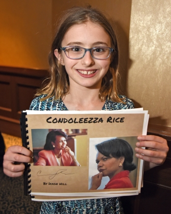 Dixon Hill, 10, holds the booklet she prepared about Condoleezza Rice for her 4th grade class at Hathaway Brown after meeting the former secretary of state during a program sponsored by the Cleveland Council on World Affairs at the InterContinental Hotel in Cleveland, Ohio, Monday, May 15, 2017. (Photo by Peggy Turbett for Currents)
