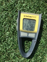 Weather station device on turf field